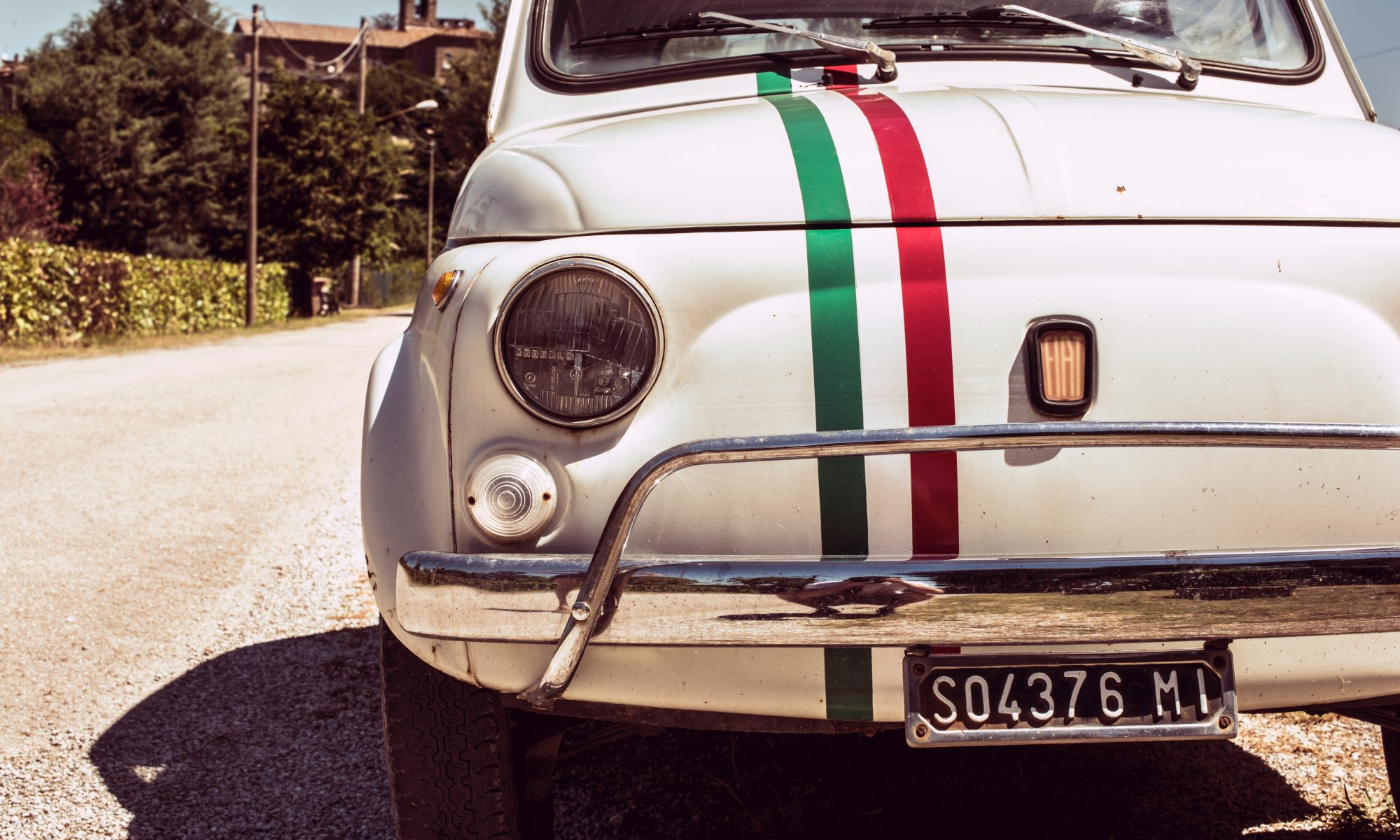 FIAT 500 white car with Italian striping on hood